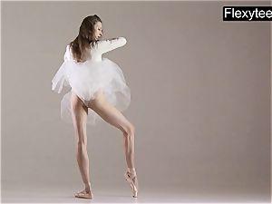 platinum-blonde gymnast performs gymnastics