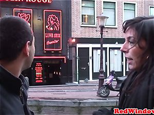 Amsterday hookers in threesome act with successful tourist