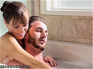 busty stepmom rubs her son-in-law and his majestic manhood